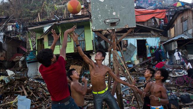 Kids play basketball in Philippines amid Typhoon Haiyan ruins